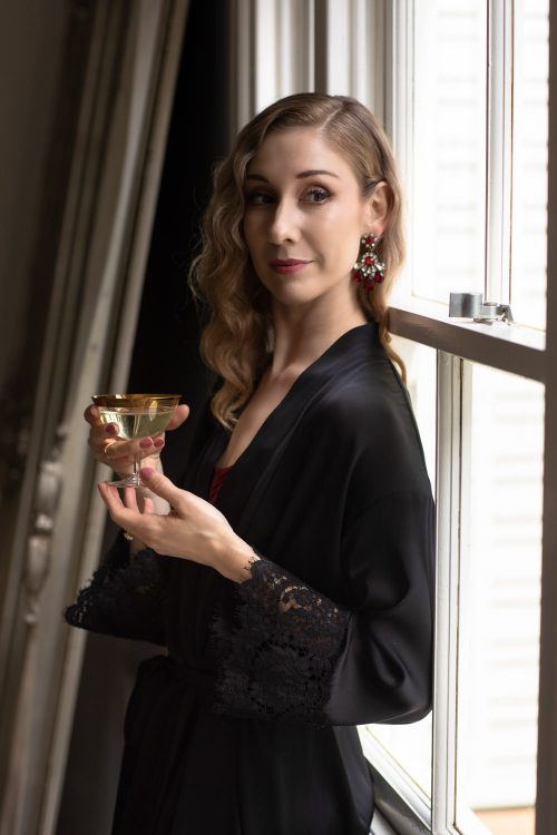 Lisa-Edwards-holding-champagne-for-launch-for-george-wu-small-business-photography